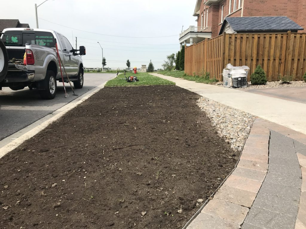sidewalk sodding in progress - interlock installation toronto