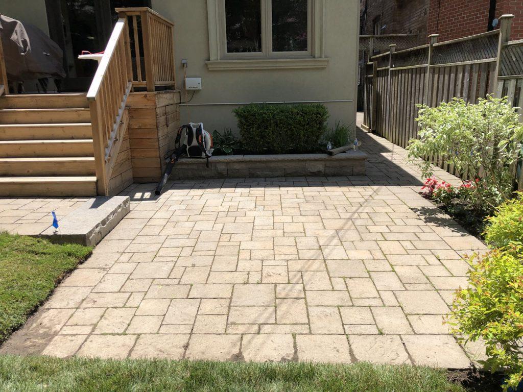 backyard interlocking maintenance before - lawn care toronto