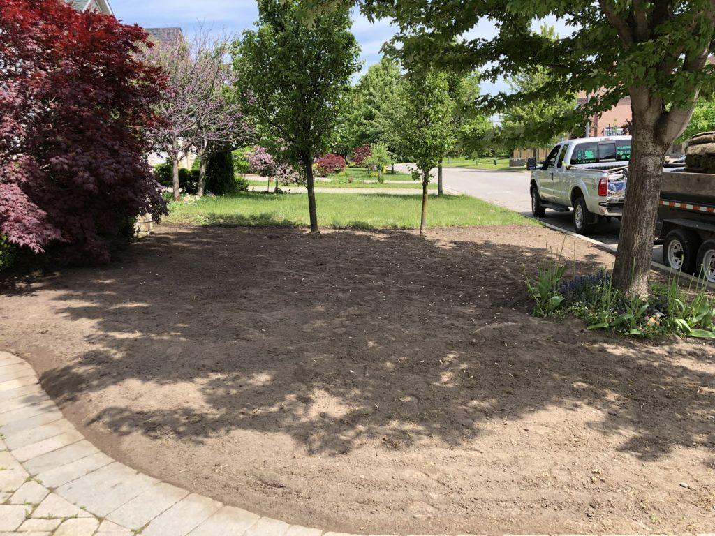 front yard sodding replacement in progress - landscape maintenance toronto