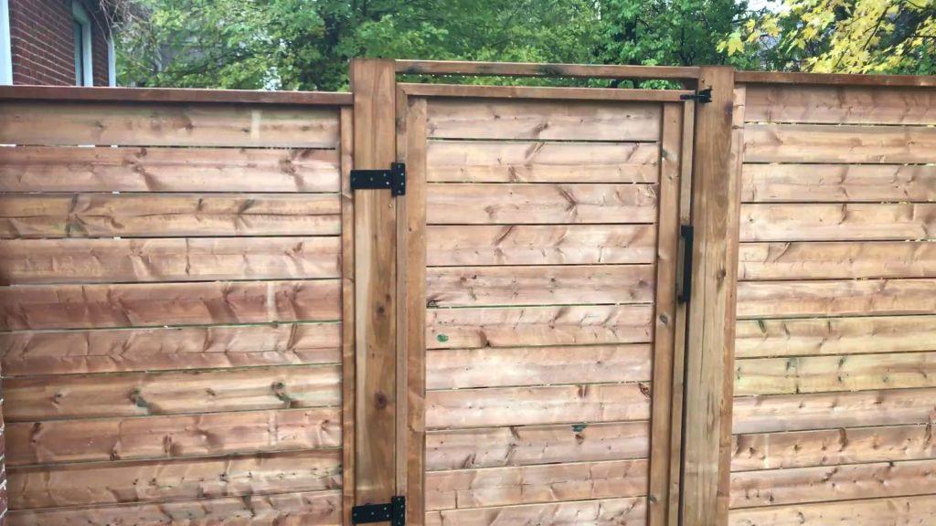backyard wood fence door installation- lawn repair toronto