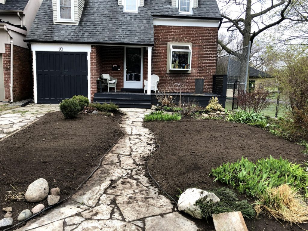 house sidewalk sodding and landscaped in progress - landscaping companies gta