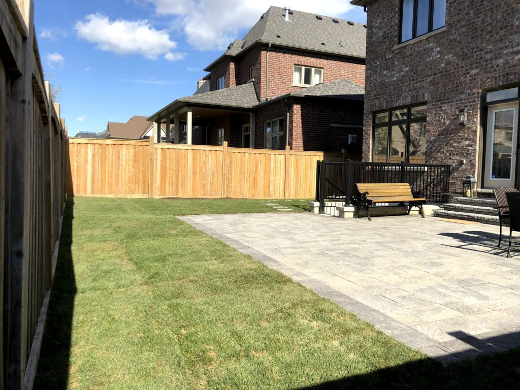 backyard lawn replacement and stone interlocking after -  interlock installation toronto