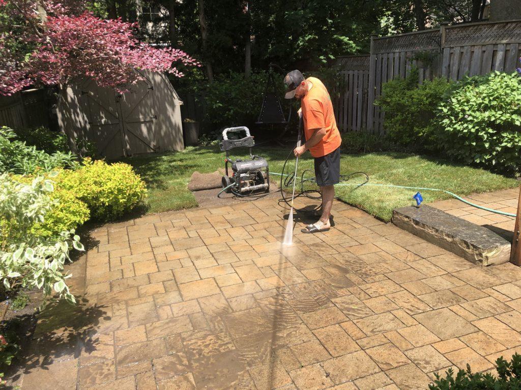 backyard interlocking maintenance in progress - lawn care toronto ontario