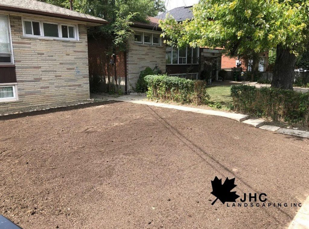 front yard lawn maintenance and sodding in progress - lawn care toronto ontario