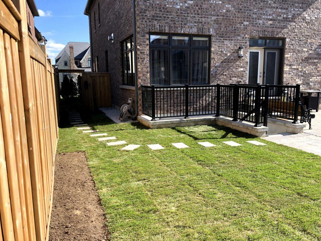 backyard lawn replacement and stone interlocking in progress -  interlock driveway cost toronto