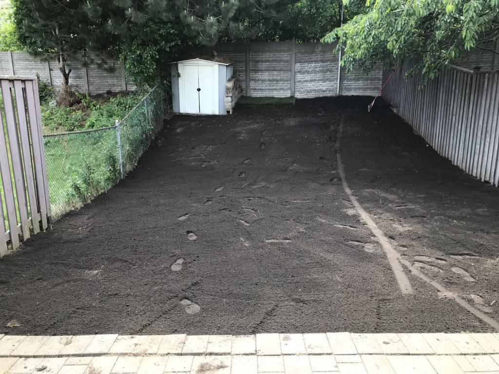small backyard sodding in progress - interlock installation toronto
