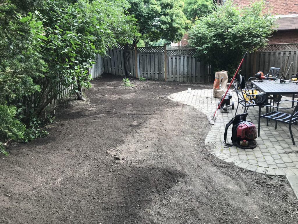 backyard sodding near patio in progress - driveway paving toronto