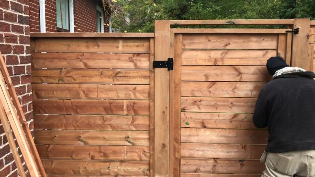 wooden fence assembly - snow removal richmond hill